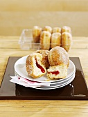 Several doughnuts on plate and in packaging