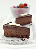 Two pieces of chocolate cheesecake