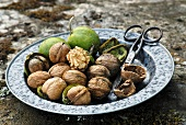 Shelled and unshelled walnuts on a plate