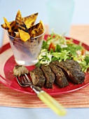 Java steak with grilled potatoes and salad