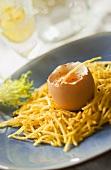 Boiled egg in potato nest
