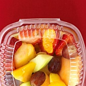 Fruit salad in a plastic container