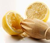 Wooden lemon squeezer and halved lemon