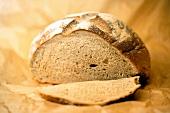 A loaf of barley bread, partly sliced