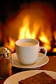 A cup of cappuccino by the fireside