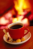 A cup of coffee by the fireside