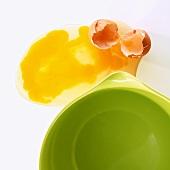 Broken egg beside dish