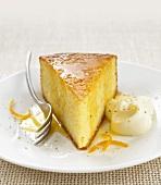 A piece of plain sponge cake with orange and lemon sauce