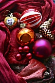 Christmas baubles on red cloth