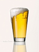 Lager in glass, with foam running over