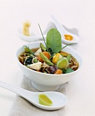 Asian noodle soup with chicken and vegetables