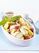 Banana split with fruit and caramel sauce