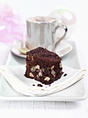 Brownie with a cup of cappuccino on a plate