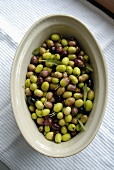 Green and black olives in an earthenware dish