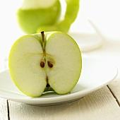 Half an apple on a plate