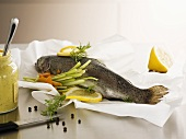 Salmon trout with vegetables on greaseproof paper
