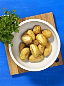 Boiled potatoes (unpeeled) in a bowl