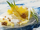 Pineapple salad with walnuts and almond foam