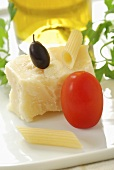 Still life: tomato, olive, Parmesan, penne & olive oil