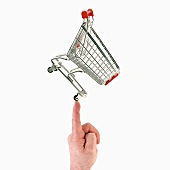 Shopping trolley on the tip of someone's finger
