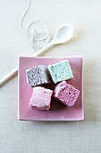 Pastel-coloured marshmallows, cooking spoon & kitchen string