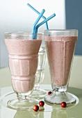 Two milkshakes with cranberries