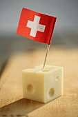 Cube of Emmental cheese with Swiss flag