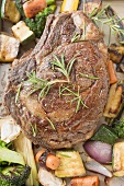 Beef steak with roasted vegetables (overhead view)