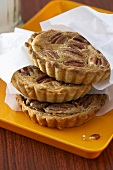 Three small pecan pies in paper bags