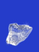 An ice cube on a blue background