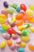 Coloured jelly beans and candy corn on sugar
