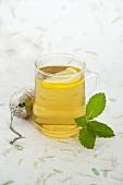 A glass of mint tea with lemon