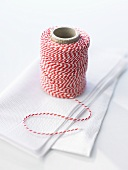 A ball of kitchen string on paper napkin