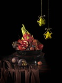 Bowl of exotic fruit & hanging decorations (carambolas) for Xmas