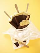 Chocolate-coated banana ice cream lollies