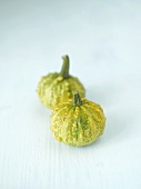 Two green ornamental gourds