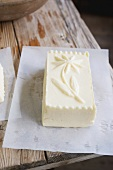 Butter with a flower design (from a wooden mould) on paper