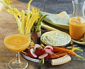 Raw vegetables with herb dip and vegetable juice