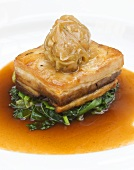 Belly pork with onion confiture on cabbage