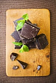 Pieces of chocolate with mint leaves