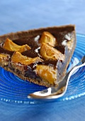A piece of chocolate and apricot tart
