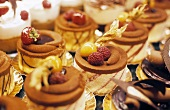 An assortment of small cakes in a patisserie