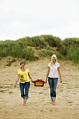 Two woman going for a picnic on the beach
