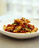 Penne all'arrabbiata (Pasta with tomato and chilli sauce)