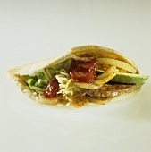 Taco filled with burger and avocado