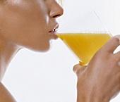 Young woman drinking orange juice