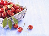 Fresh cherries in a small basket