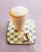 A beaker of latte macchiato