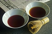 Tea in tea bowls with tea whisk