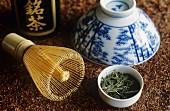Still life with tea whisk, green tea, tea bowl & tea caddy